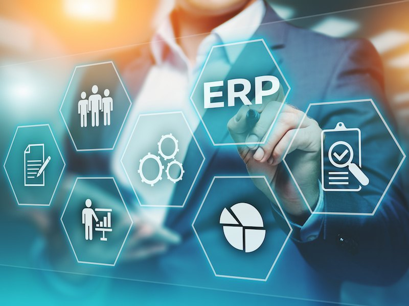 Business executive considering how to optimize usability of Oracle ERP software